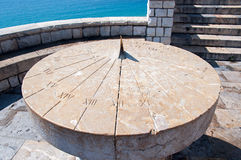 Ancient sundial in Tarragona, Spain. Spain. Tarragona. Ancient sundial on a Stone platform Stock Image