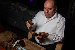 SPAIN, TENERIFE, ABAMA RITZ, FEBRUARY 2016: Torcedor rolling hand made cigars parejos Royalty Free Stock Image