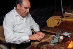 SPAIN, TENERIFE, ABAMA RITZ, FEBRUARY 2016: Torcedor rolling hand made cigars parejos Royalty Free Stock Photos