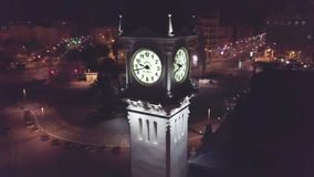 Spain, Valencia, aerial shoot, view of high tower with clock night sight. VALENCIA, SPAIN - February, 2018: Aerial view of architecture in night Valencia. Spain stock video footage