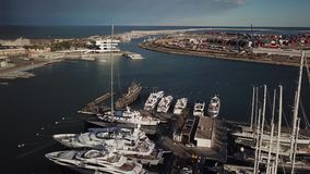 Spain, Valencia aerial shooting, bird-eye view of port, sailboats, yachts, bay. Spain, Valencia aerial shooting, bird-eye view of port, bay and sailboats, cool stock video