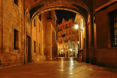 Spain. Valencia. Night cityscape in the historical streets.  Ol. D town, narrow street at night. Mysterious alley with arch and with lanterns Stock Image