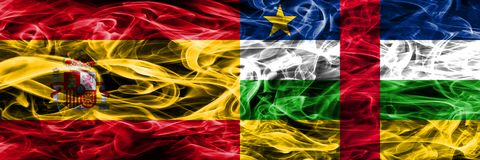 Spain vs Central African Republic smoke flags placed side by sid. E. Thick colored silky smoke flags of Spanish and Central African Republic stock images