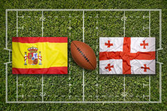 Spain vs. Georgia flags on rugby field Royalty Free Stock Photography