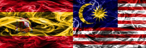 Spain vs Malaysia smoke flags placed side by side. Thick colored. Silky smoke flags of Spanish and Malaysia Royalty Free Illustration