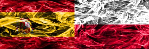 Spain vs Poland smoke flags placed side by side. Thick colored s. Ilky smoke flags of Spanish and Poland Royalty Free Stock Photography