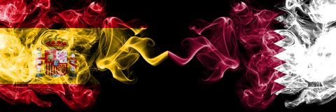 Spain vs Qatar, Qatari smoky mystic flags placed side by side. Thick colored silky smokes flag of Spanish and Qatar, Qatari. Spain vs Qatar, Qatari smoky mystic royalty free stock photos