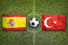 Spain vs. Turkey flags on soccer field Stock Photography