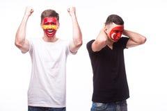 Spain vs Turkey. Football fans of national teams demonstrate emotions: Spain win, Turkey lose. Stock Image