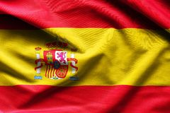 Spain waving flag. Close up fabric background royalty free stock photos