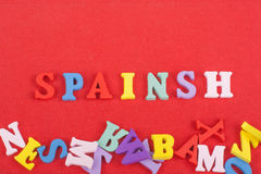 SPAIN word on red background composed from colorful abc alphabet block wooden letters, copy space for ad text. Learning. English concept stock images