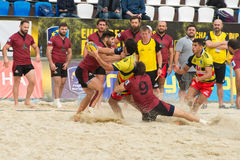 Spain yellow vs Georgia violet. MOSCOW, RUSSIA - JULY 22-23, 2017: Rugby players in action at the  on European Beach Fives Rugby Championship 2017 in the match Stock Images