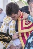 Spainish bullfighter Daniel Luque putting itself the walk cape i Stock Photos