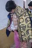 Spainish bullfighter Jose Tomas putting itself the walk cape in Royalty Free Stock Photo