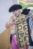 Spainish bullfighter Jose Tomas putting itself the walk cape in Royalty Free Stock Photos