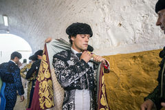 Spainish bullfighter Miguel Abellan putting itself the walk cape Stock Image