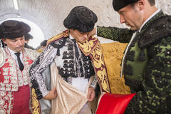 Spainish bullfighter Miguel Abellan putting itself the walk cape Stock Photo