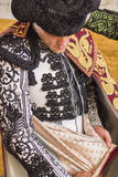 Spainish bullfighter Miguel Abellan putting itself the walk cape Stock Photography