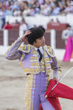 Spainish bullfighter Sebastian Castella taking the cap from him Royalty Free Stock Image