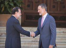 Spains King and Prime minister shaking hands Stock Photo