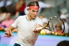 Spains Rafael Nadal en la acción durante el tenis Ope de Madrid Mutua Imágenes de archivo libres de regalías