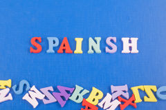 Spainsh word on blue background composed from colorful abc alphabet block wooden letters, copy space for ad text Royalty Free Stock Photos