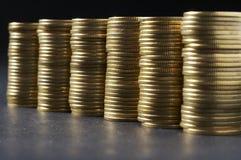 Spalte vom Geld Stockfotos