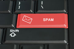 Spam button in red on a keyboard Royalty Free Stock Photography
