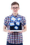 Spam concept - handsome teenage boy sending messages with laptop. Isolated on white background Stock Photos
