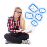 Spam concept - young beautiful astonished blondie woman sitting Royalty Free Stock Photography