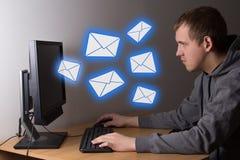 Spam concept - young man using a computer Stock Photos