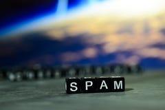 Spam en bloques de madera Imagen procesada cruz con el fondo del bokeh imágenes de archivo libres de regalías