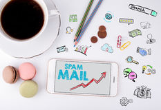 Spam Mail, Business Concept. Mobile phone and coffee cup on a white office desk Stock Images
