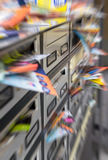 Spam in mailboxes. Mailboxes filled with paper flyers. Symbol for advertising, mail, marketing, spam. Defocused blurry background Stock Photography