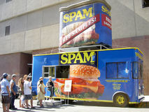 Spam mobile. San Jose, California - April 2002: People lined up in front of Spam truck offering free samples Royalty Free Stock Image