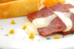 Spam And Mustard. Fried spam with delicious fried toast fingers and mustard drops Royalty Free Stock Images