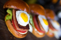 Spam sliders. Jaunty spam sliders topped with a fried egg. this is a hawaiian staple and very popular Stock Photography