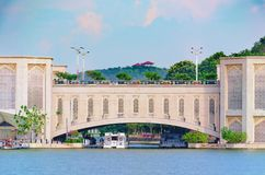 Span of arched bridge over the river. View of the water bridge, shipping construction. Details of Islamic architecture, oriental patterns. Putra Bridge stock photo