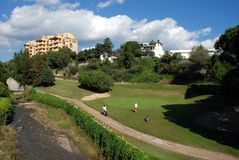 Golfers at the Rio Real Golf Club, Marbella, Spain. Two women playing golf on the putting green at the Rio Real Golf Club, Marbella, Costa del Sol, Malaga royalty free stock photos