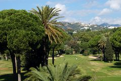 Rio Real Golf Club, Marbella, Spain. View across the Rio Real Golf Club with golfers in the centre, Marbella, Costa del Sol, Malaga Province, Andalucia, Spain royalty free stock images