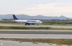 Spanair plane for takeoff roll in Barcelona Stock Images