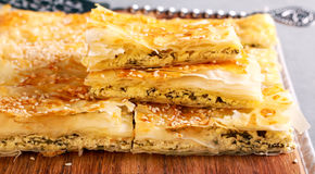Spanakopita or spinach pie - a Greek savory pastry Stock Image