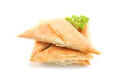 Spanakopita triangles. With spinach and cheese  isolated on white Royalty Free Stock Image