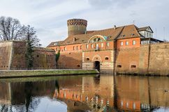 Spandau Citadel with its Julius tower, gate house and a draw bridge in Berlin, Germany. Spandau Citadel, one of the best preserved Renaissance military stock images