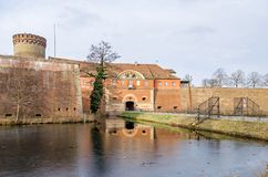 Spandau Citadel with its Julius tower, gate house and a draw bridge in Berlin, Germany. Spandau Citadel, one of the best preserved Renaissance military royalty free stock photo