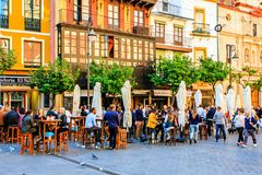 Sunday in Sevilla, Spain. Spaniards celebrate their free Sunday afternoon with good weather on the terraces near the cathedral Royalty Free Stock Photo