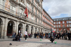 Spaniards and foreigners. Madrid, Spain - February 21, 2014: Spaniards and foreigners work in the Plaza Mayor in Madrid to earn money Royalty Free Stock Image