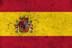 Spanien-Flagge auf gebrochenem Wandbeschaffenheitshintergrund Stockfotografie
