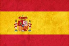 Spanien-Flagge auf Papierbeschaffenheitshintergrund Lizenzfreie Stockfotos