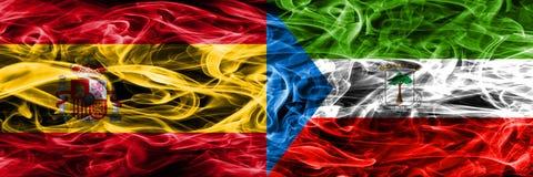 Spanien gegen die Äquatorialguinearauchflaggen nebeneinander gesetzt Thic lizenzfreie abbildung